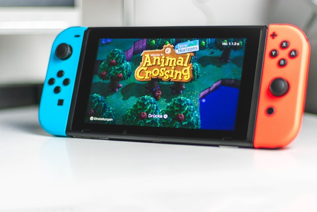 Switch game console with Animal Crossing intro screen.